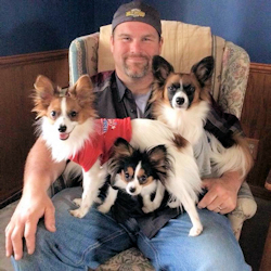JAKE WITH 3 DOGS ON HIS LAP